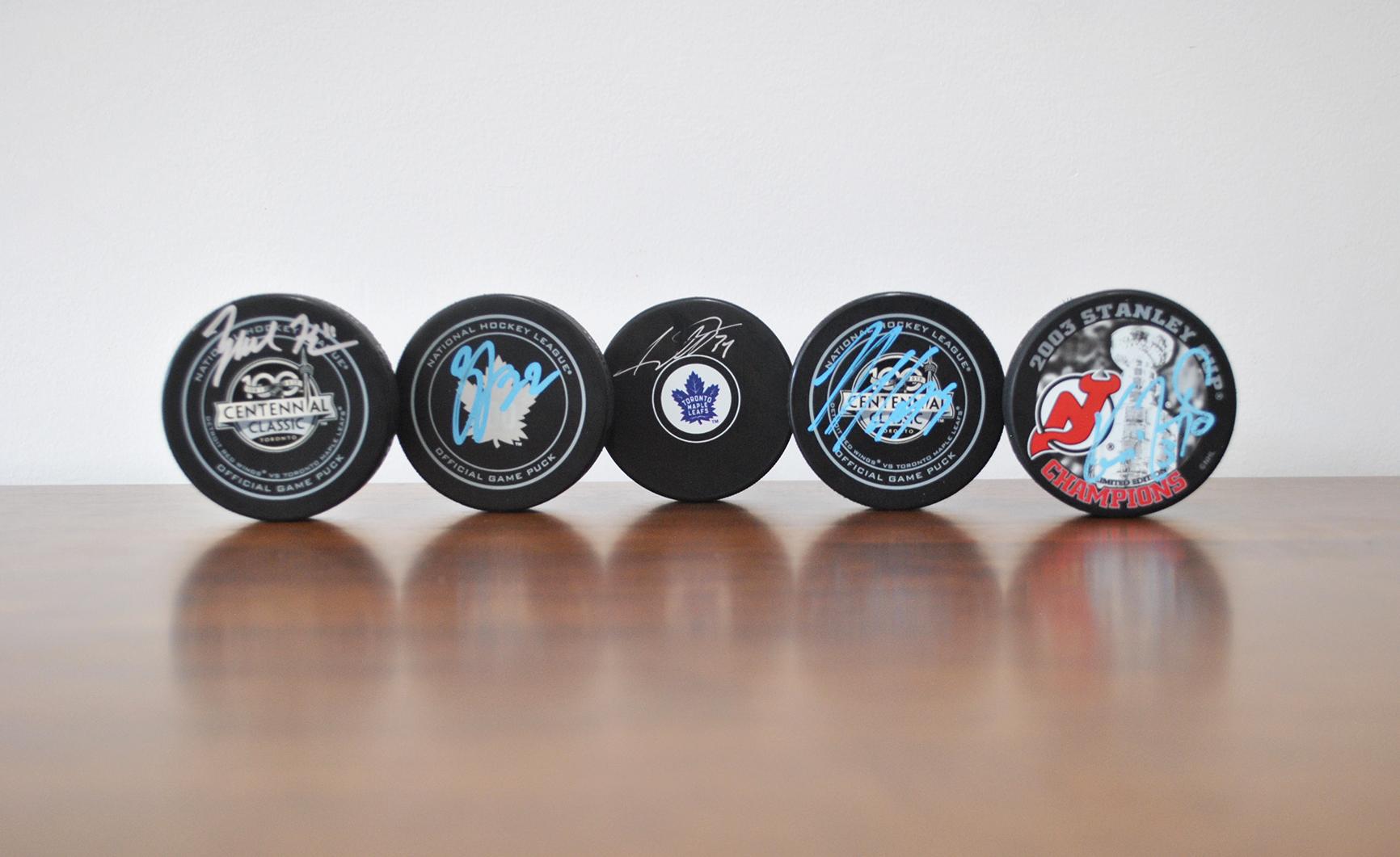 Various Signed NHL Pucks